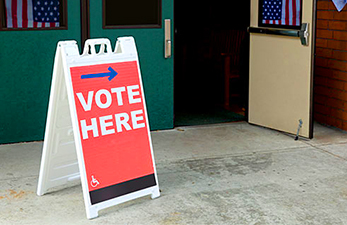 sign pointing to voting locations